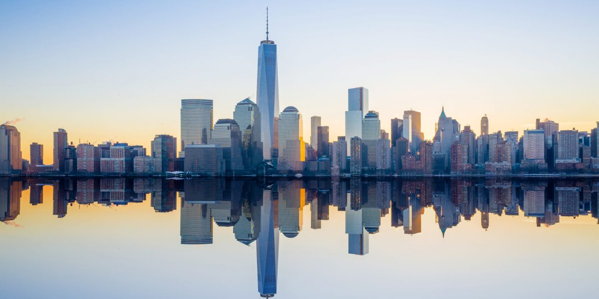 Manhattan Skyline with the One World Trade Center building at twilight, New York City